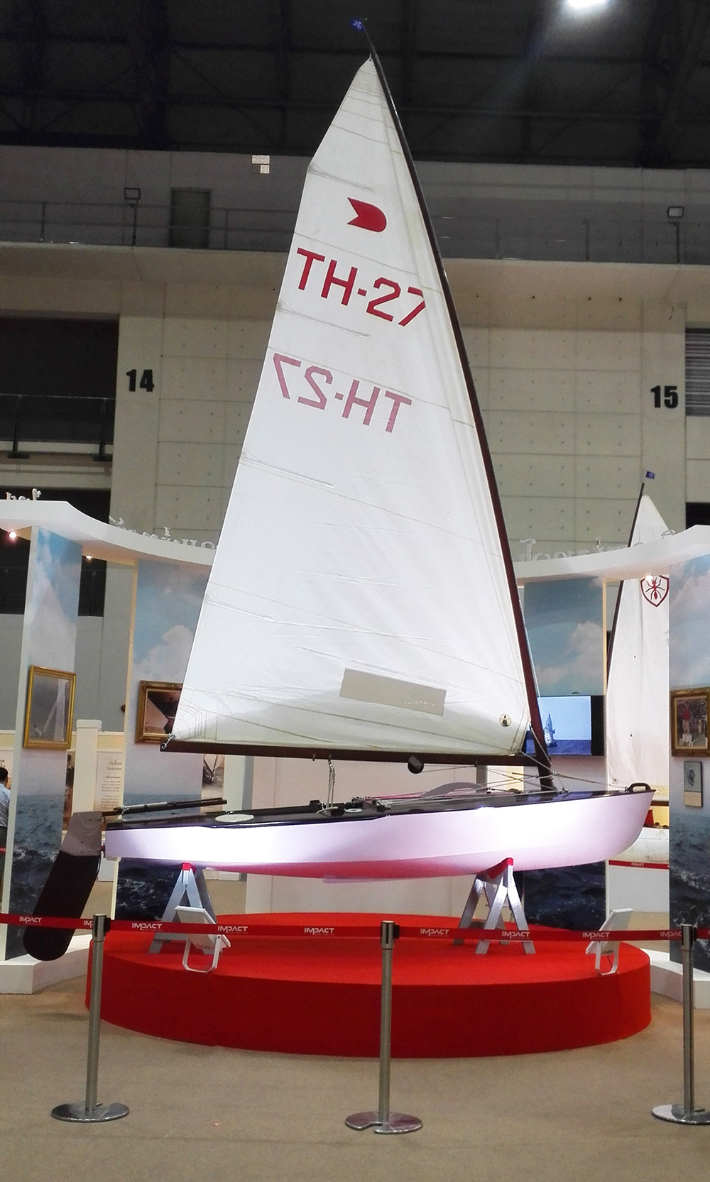"OK Dinghy ""Vega 2"", built by His Majesty the late King Bhumipol Adulyadej of Thailand 50 years ago. Here on display at the 2016 National Science and Technology Fair in Bangkok at IMPACT Muang Thani."