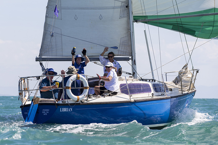 Librian crew waving off their competitors. SeaLink Magnetic Island Race Week 2017.