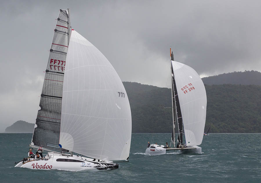 Close battle between Voodoo and Twin Sharks in the Firefly class. Day 2, Cape Panwa Hotel Phuket Raceweek 2019.